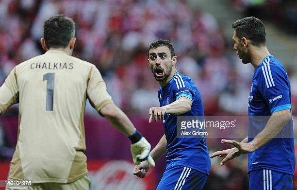 Konstantinos Chalkias and Giannis Maniatis of Greece react during the UEFA EURO 2012 group A match between Poland and Greece at National Stadium on...