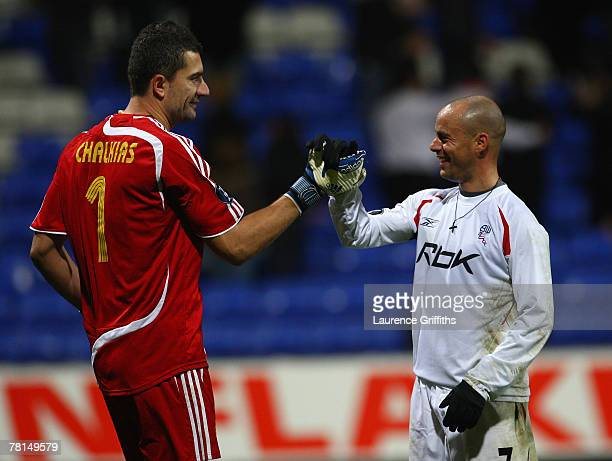 Konstantinos Chalkias of Aris Thessaloniki and Stelios of Bolton Wanderers shake hands at the end of the UEFA Cup Group F match between Bolton...