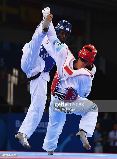 Konstantinos Gkoltsios of Greece and Mahama Cho of Great Britain compete in the Men's 80kg Taekwondo Preliminary Round during day seven of the Baku...