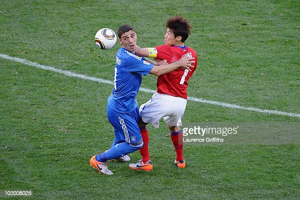 Konstantinos Katsouranis of Greece and Park JiSung of South Korea lose the flight of the ball during the 2010 FIFA World Cup South Africa Group B...