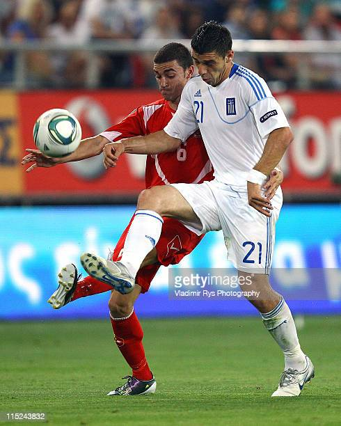 Konstantinos Katsouranis of Greece and Ryan Fenech of Malta in action during the EURO 2012 group F qualifying match between Greece and Malta at...