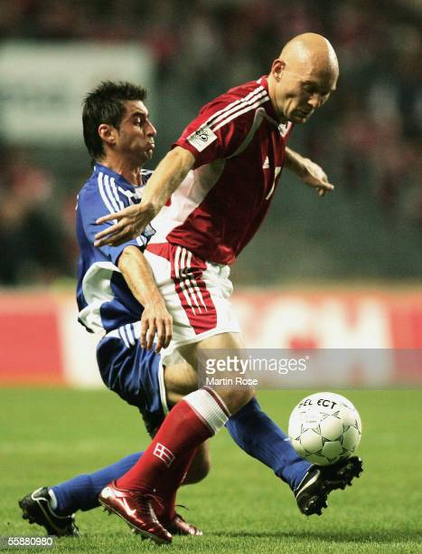 Konstantinos Katsouranis of Greece and Thomas Gravesen of Denmark fights for the ball during the FIFA World Cup 2006 Group 2 Qualifier match between...
