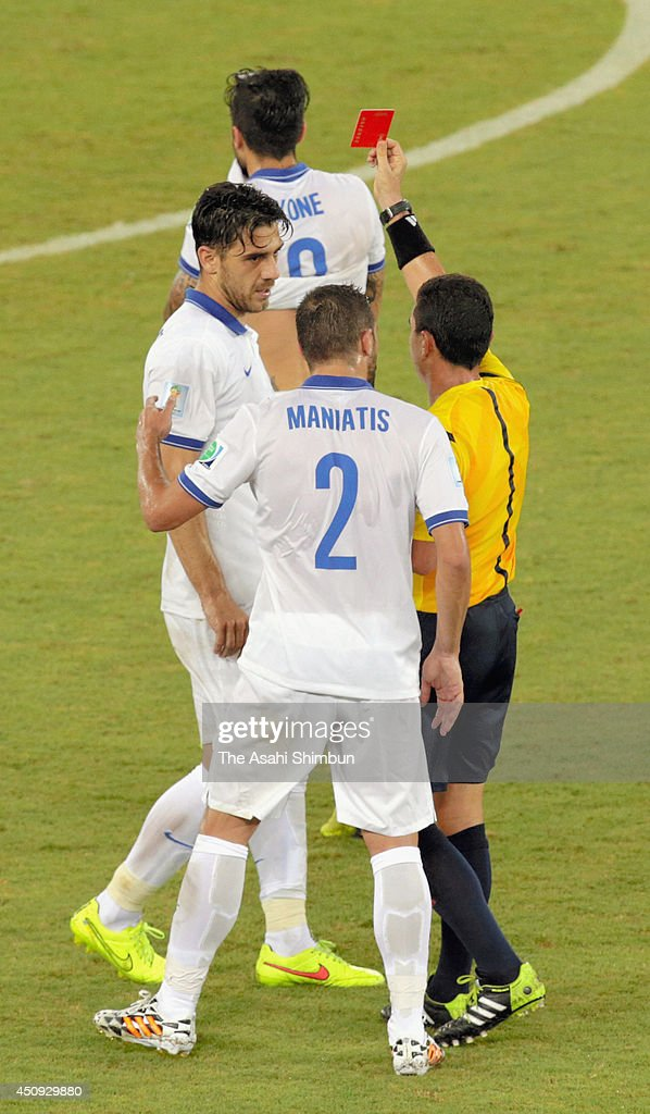 Konstantinos Katsouranis of Greece is shown a red card during the 2014 FIFA World Cup Brazil Group C match between Japan and Greece at Estadio das Dunas on June 19, 2014 in Natal, Brazil.