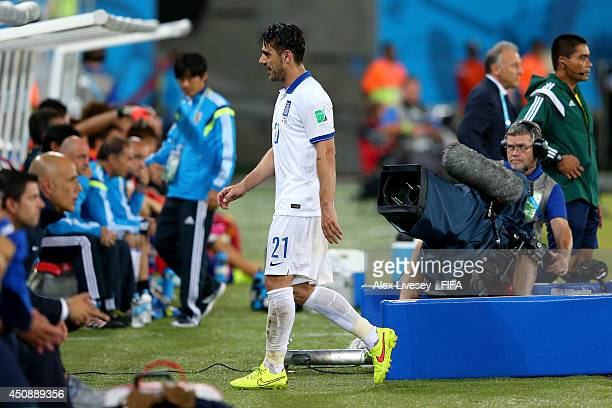 Konstantinos Katsouranis of Greece walks off the pitch after receiving a red card during the 2014 FIFA World Cup Brazil Group C match between Japan...