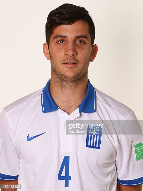Konstantinos Manolas of Greece poses during the official FIFA World Cup 2014 portrait session on June 10 2014 in Aracaju Brazil