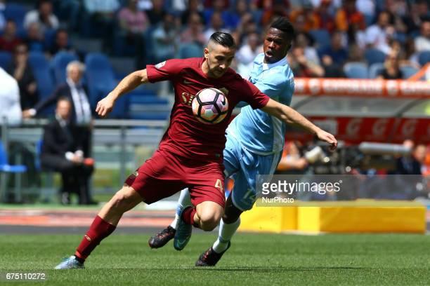 Konstantinos Manolas of Roma vies Balde Diao Keita of Lazio during the Italian Serie A football match Roma vs Lazio at the Olympic Stadium in Rome on...