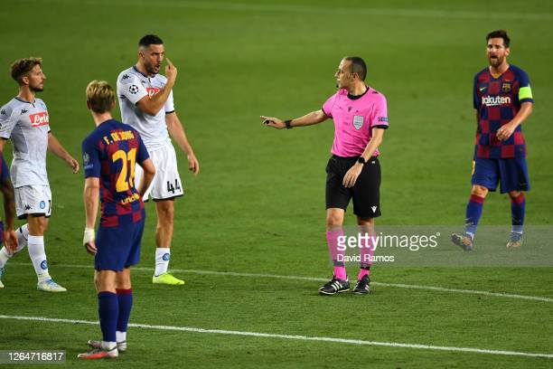 Konstantinos Manolas of SSC Napoli argues with the match referee during the UEFA Champions League round of 16 second leg match between FC Barcelona...