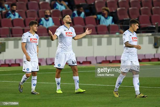 Konstantinos Manolas of SSC Napoli raises his arm to the sky as he walks on the pitch the UEFA Champions League round of 16 second leg match between...