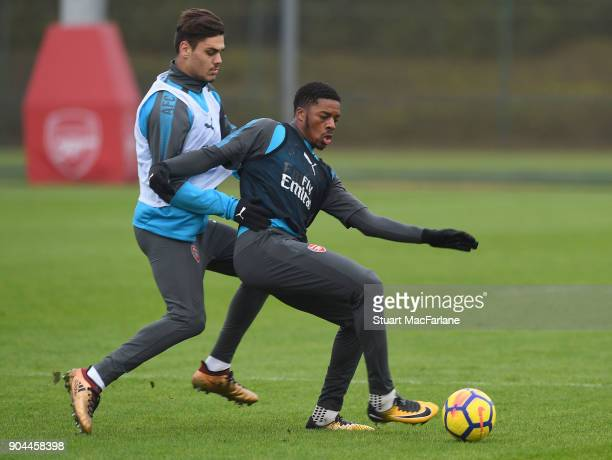 Konstantinos Mavropano and Chuba Akpom of Arsenal during a training session at London Colney on January 13 2018 in St Albans England