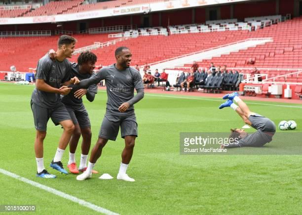 Konstantinos Mavropanos Alex Iwobi Alex Lacazette and Matteo Guendouzi of Arsenal during a training session at Emirates Stadium on August 11 2018 in...