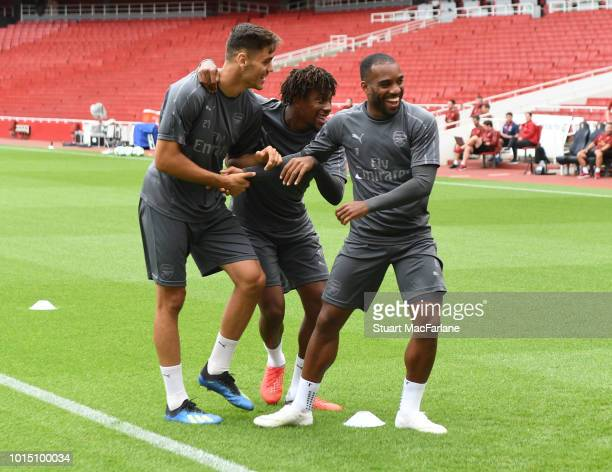 Konstantinos Mavropanos and Alex Iwobi Alex Lacazette of Arsenal during a training session at Emirates Stadium on August 11 2018 in London England