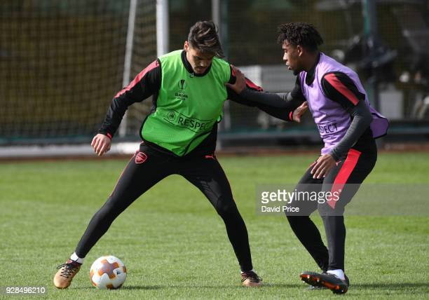 Konstantinos Mavropanos and Alex Iwobi of Arsenal during the Arsenal Training Session at London Colney on March 7 2018 in St Albans England