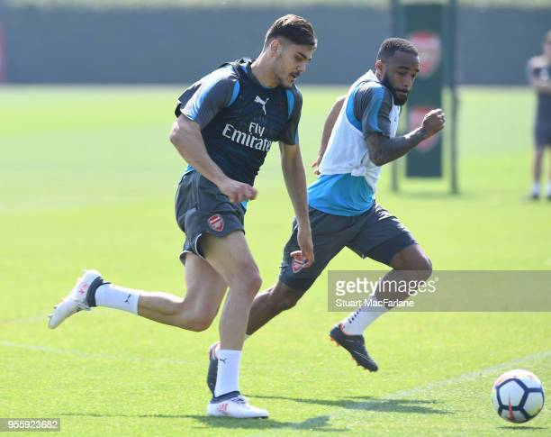 Konstantinos Mavropanos and Alex Lacazette of Arsenal during a training session at London Colney on May 8 2018 in St Albans England