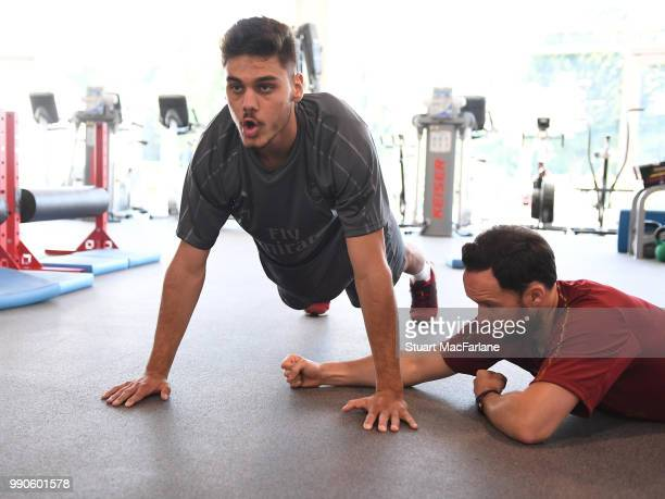 Konstantinos Mavropanos and Arsenal fitness coach Barry Solan during a medical screening session at London Colney on July 3 2018 in St Albans England
