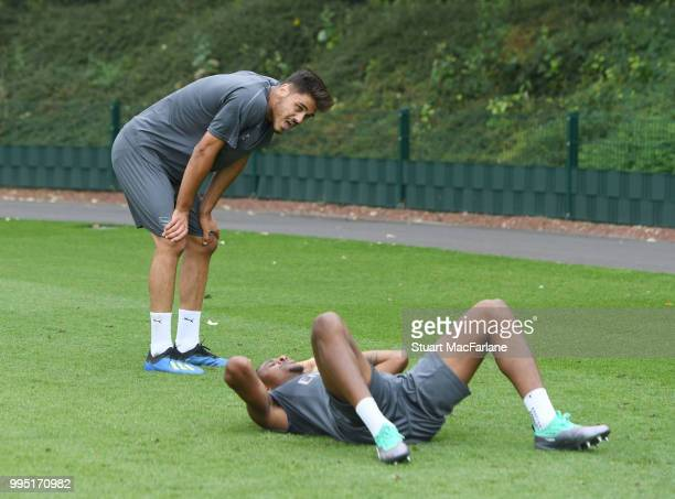 Konstantinos Mavropanos and Chuba Akpom of Arsenal after a training session at London Colney on July 10 2018 in St Albans England