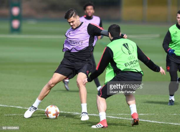 Konstantinos Mavropanos and Henrikh Mkhitaryan of Arsenal during a training session at London Colney on March 14 2018 in St Albans England