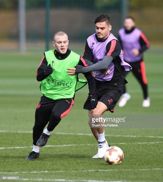 Konstantinos Mavropanos and Jack WIlshere of Arsenal during a training session at London Colney on March 14 2018 in St Albans England