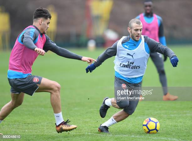 Konstantinos Mavropanos and Jack Wilshere of Arsenal during training at London Colney on March 10 2018 in St Albans England