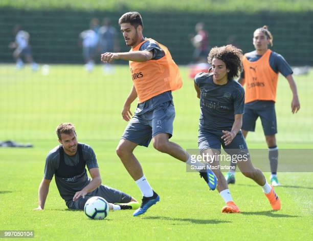Konstantinos Mavropanos and Matteo Guendouzi of Arsenal during a training session at London Colney on July 12 2018 in St Albans England