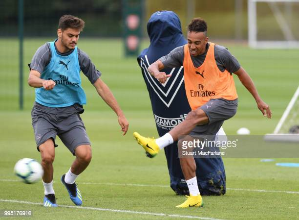 Konstantinos Mavropanos and PierreEmerick Aubameyang of Arsenal during a training session at London Colney on July 10 2018 in St Albans England