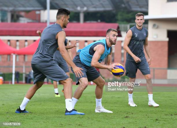 Konstantinos Mavropanos Calum Chambers and Rob Holding of Arsenal during a training session at Singapore American School on July 24 2018 in Singapore