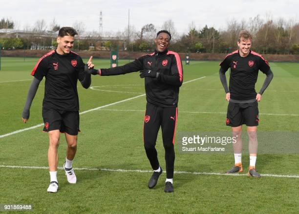 Konstantinos Mavropanos Danny Welbeck and Rob Holding of Arsenal during a training session at London Colney on March 14 2018 in St Albans England