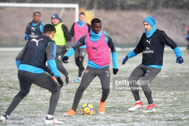 Konstantinos Mavropanos Eddie Nketiah and Henrikh Mkhitaryan of Arsenal during a training session at London Colney on February 28 2018 in St Albans...