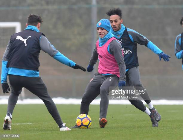 Konstantinos Mavropanos Jack Wilshere and PierreEmerick Aubameyang of Arsenal during a training session at London Colney on March 3 2018 in St Albans...