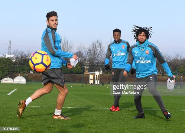 Konstantinos Mavropanos Joe Willock and Mohamed Elneny of Arsenal during a training session at London Colney on January 6 2018 in St Albans England