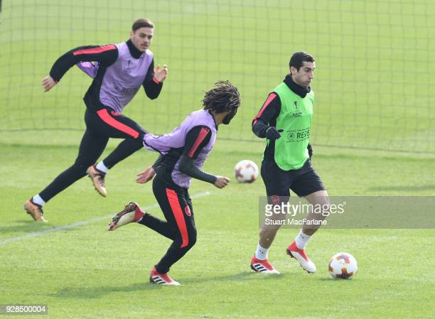 Konstantinos Mavropanos Mohamed Elneny and Henrikh Mkhitaryan of Arsenal during a training session at London Colney on March 7 2018 in St Albans...