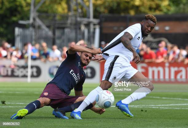 Konstantinos Mavropanos of Arsenal challenges Morgan Ferrier of Borehamwood during the match between Borehamwood and Arsenal at Meadow Park on July...