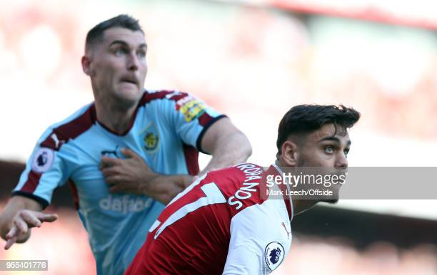 Konstantinos Mavropanos of Arsenal gets a grip on Sam Vokes of Burnley during the Premier League match between Arsenal and Burnley at Emirates...