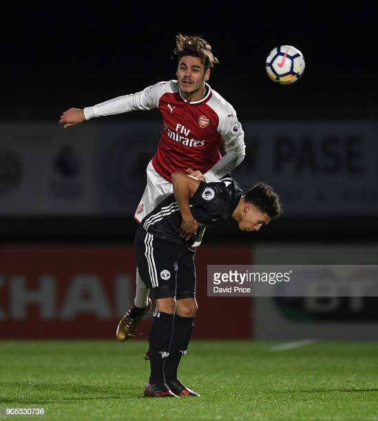 Konstantinos Mavropanos of Arsenal heads the ball under pressure from Nishan Burkart of Man Utd during the Premier League 22 match between Arsenal...
