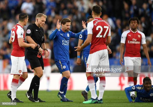 Konstantinos Mavropanos of Arsenal is shown a red card by referee Graham Scott during the Premier League match between Leicester City and Arsenal at...