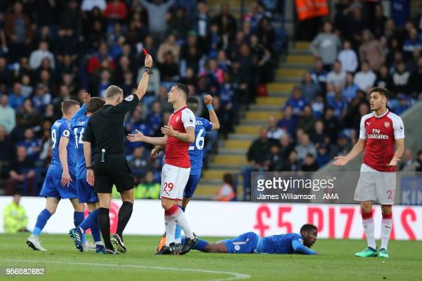 Konstantinos Mavropanos of Arsenal is shown a red card during the Premier League match between Leicester City and Arsenal at The King Power Stadium...
