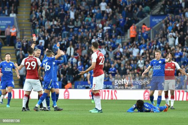 Konstantinos Mavropanos of Arsenal is shown the red card by referee Graham Scott for a foul on Kelechi Iheanacho of Leicester City during the Premier...