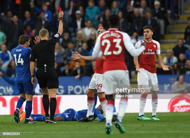 Konstantinos Mavropanos of Arsenal is shown the red card during the Premier League match between Leicester City and Arsenal at The King Power Stadium...
