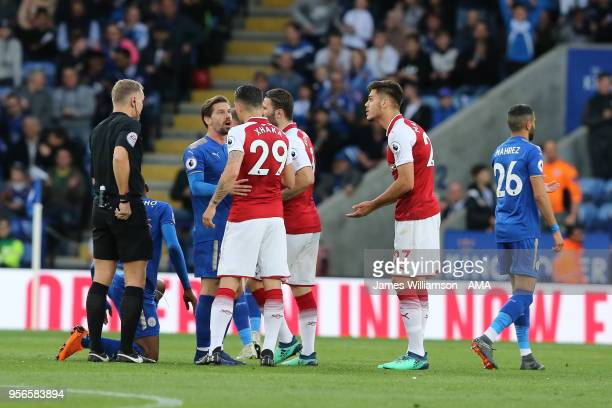 Konstantinos Mavropanos of Arsenal protests to match referee Graham Scott after receiving a red card during the Premier League match between...