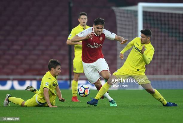 Konstantinos Mavropanos of Arsenal takes on Pedro Martinez Garcia and Sergio Lozano Lluch of Villarreal during the match between Arsenal U23 and...