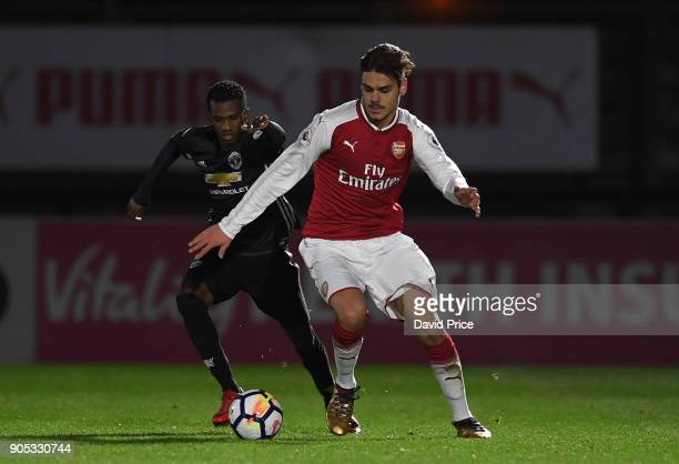 Konstantinos Mavropanos of Arsenal under pressure from Josh Bouhi of Man Utd during the Premier League 22 match between Arsenal and Manchester United...