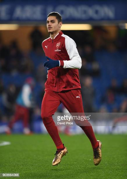 Konstantinos Mavropanos of Arsenal warms up before the Carabao Cup Semie Final 1st leg match between Chelsea and Arsenal at Stamford Bridge on...