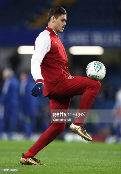 Konstantinos Mavropanos of Arsenal warms up before the Carabao Cup SemiFinal First Leg match between Chelsea and Arsenal at Stamford Bridge on...