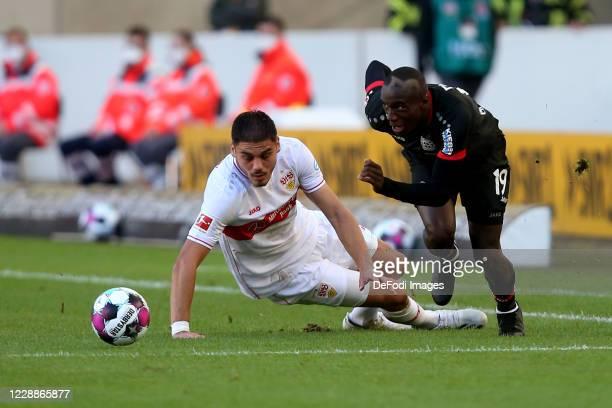 Konstantinos Mavropanos of VfB Stuttgart and Moussa Diaby of Bayer 04 Leverkusen battle for the ball during the Bundesliga match between VfB...