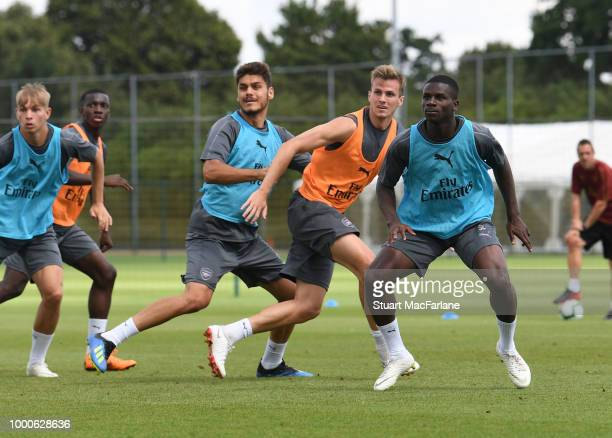 Konstantinos Mavropanos Rob Holding and Jordi OseiTutu of Arsenal during a training session at London Colney on July 17 2018 in St Albans England