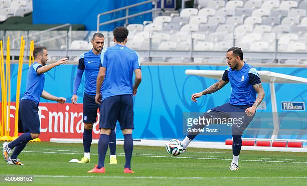 Konstantinos Mitroglou of Greece controls the ball during the training session ahead of the Group C match between Greece and Colombia as part of FIFA...