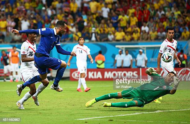 Konstantinos Mitroglou of Greece has his shot saved by Keylor Navas of Costa Rica in extra time during the 2014 FIFA World Cup Brazil Round of 16...