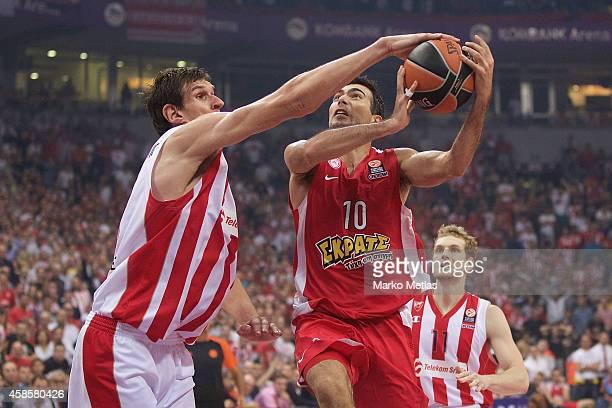 Konstantinos Sloukas, #10 of Olympiacos Piraeus competes with Boban Marjanovic, #13 of Crvena Zvezda Telekom Belgrade during the 2014-2015 Turkish...