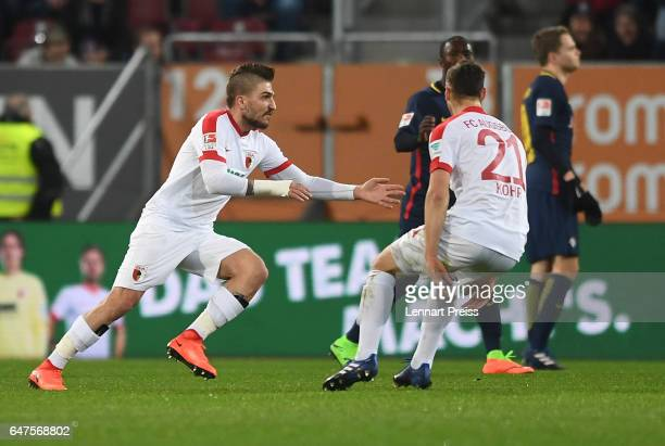 Konstantinos Stafylidis and Dominik Kohr of FC Augsburg ceebrate their side's first goal during the Bundesliga match between FC Augsburg and RB...