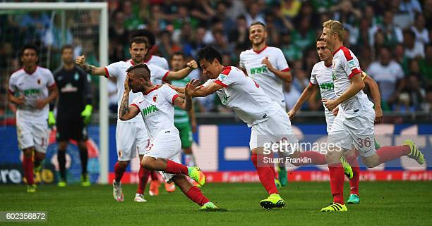Konstantinos Stafylidis of Augsburg celebrates scoring his goal during the Bundesliga match between Werder Bremen and FC Augsburg at Weserstadion on...