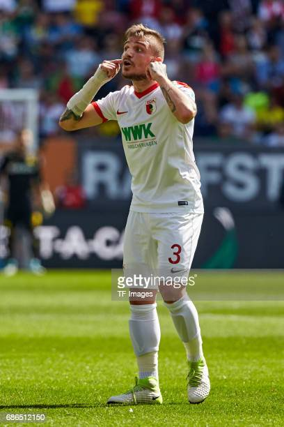 Konstantinos Stafylidis of Augsburg gestures during the Bundesliga match between FC Augsburg and Borussia Dortmund at the WWKArena on May 13 2017 in...